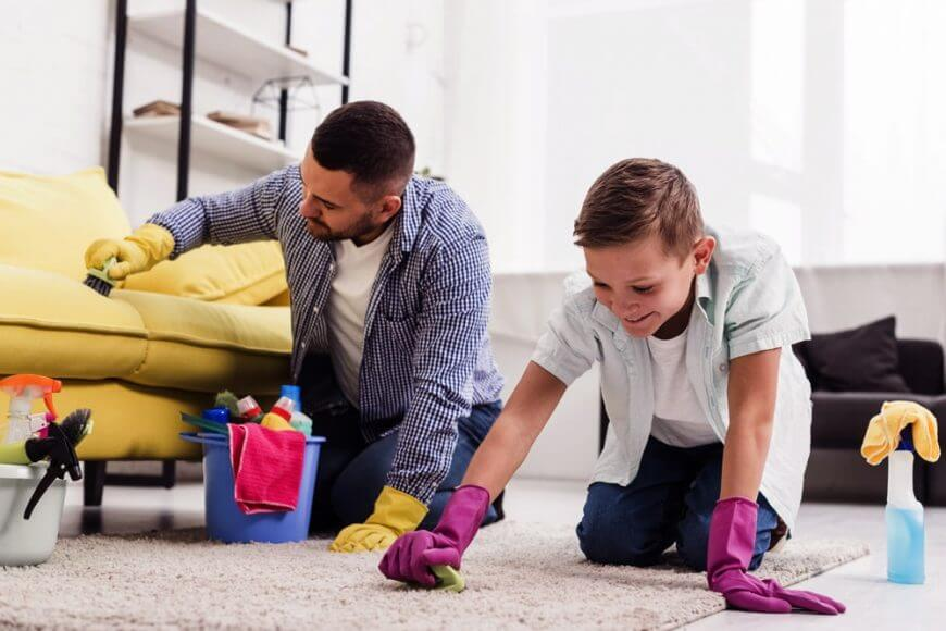 Two people cleaning carpet